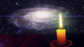 A luz de uma vela e de uma galáxia ilustração stock