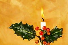 Luz de una vela de la Navidad Imagen de archivo