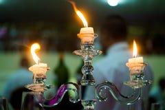Luz de una vela del fuego Foto de archivo libre de regalías