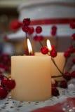 Luz de una vela y espinos del día de fiesta Fotos de archivo libres de regalías