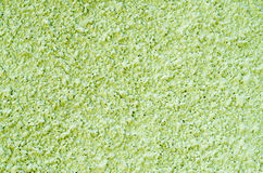 Luz decorativa - emplastro verde do relevo na parede Foto de Stock