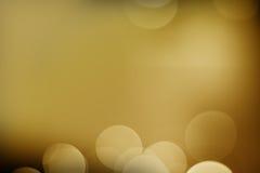 Luz del oro con el fondo negro Foto de archivo