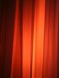 Luz del punto contra la cortina Fotografía de archivo libre de regalías