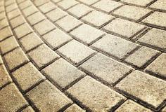 Luz del sol en el pavimento pavimentado del guijarro Imágenes de archivo libres de regalías