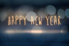 Luz del sprkler de la Feliz Año Nuevo en fondo del bokeh de Aabstract Imágenes de archivo libres de regalías