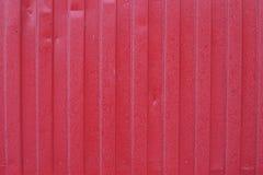 Luz do dia natural do fundo vermelho da cerca imagens de stock