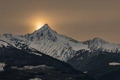 Luz do pico nevado enfim Imagem de Stock