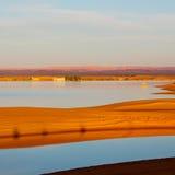 luz do sol no deserto do amarelo do lago da areia e da duna de Marrocos Fotografia de Stock Royalty Free