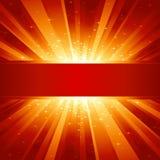 A luz dourada vermelha estourou com estrelas e copyspace Imagens de Stock