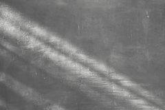 Luz e sombra no fundo da parede do cimento Fotografia de Stock