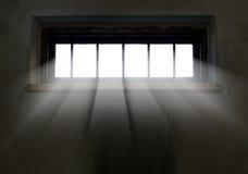 A luz está vindo através da janela barrada fotos de stock
