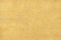 Luz - fundo amarelo da tela de ensaque tecida densa, close up Estrutura do macro de matéria têxtil fotografia de stock royalty free