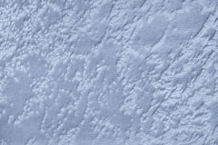Luz - fundo azul de um material de matéria têxtil macio de estofamento, close up Foto de Stock