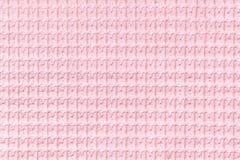 Luz - fundo cor-de-rosa do fim felpudo macio da tela acima Textura das matérias têxteis macro fotografia de stock royalty free
