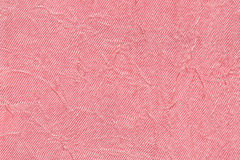 Luz - fundo ondulado cor-de-rosa de um material de matéria têxtil Tela com o close up da textura da dobra Foto de Stock