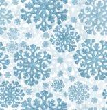 Luz - fundo sem emenda dos flocos de neve azuis Imagem de Stock Royalty Free