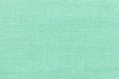 Luz - fundo verde de um material de matéria têxtil com teste padrão de vime, close up fotografia de stock