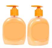 Luz - garrafas marrons do sabão líquido Imagem de Stock