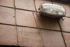 Luz industrial en una fachada Fotografía de archivo libre de regalías