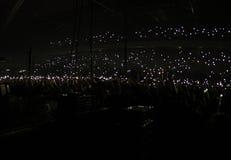 Luz instantânea de um telefone celular em um concerto da música Fotografia de Stock Royalty Free