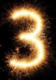Luz número 3 do fogo de artifício do chuveirinho isolado no preto Imagem de Stock Royalty Free