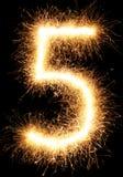 Luz número 5 do fogo de artifício do chuveirinho isolado no preto Imagens de Stock