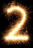 Luz número 2 do fogo de artifício do chuveirinho isolado no preto Imagens de Stock