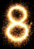 Luz número 8 do fogo de artifício do chuveirinho isolado no preto Imagem de Stock