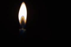Luz obscura da vela Foto de Stock Royalty Free