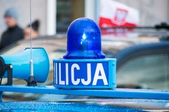 Luz que destella en el coche de Milicja Milicja es viejo nombre para la policía en Polonia Fotos de archivo libres de regalías