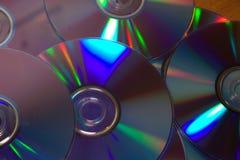 Luz refletindo do arco-íris de DVDs Imagem de Stock Royalty Free