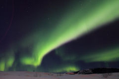 Luz septentrional muy verde Fotos de archivo libres de regalías