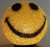 Luz sonriente de la cara Fotos de archivo