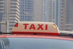 Luz superior del taxi ocupado Foto de archivo libre de regalías