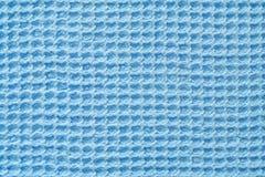 Luz - tela azul do waffle como a textura imagem de stock