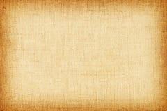 Luz - textura de linho natural amarela para o fundo Fotografia de Stock