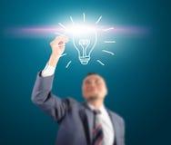 Luz tocante do homem de negócio da ideia Imagens de Stock Royalty Free