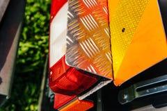Luz trasera de un tractor con la protección Fotografía de archivo