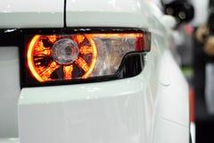 Luz trasera del primer del fondo blanco del coche de la bota Fotos de archivo libres de regalías