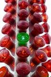 Luz verde con las luces rojas Foto de archivo libre de regalías