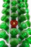 Luz vermelha com luzes verdes Imagens de Stock Royalty Free