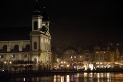 Luzern by night from the lake, switzerland. royalty free stock image