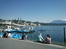 Luzern lake side. People resting Stock Photography