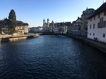 LUZERN, SWITZERLAND - NOVEMBER 4, 2016: Old building in town with Reuss river in the winter season. stock photos
