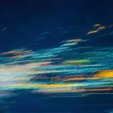 Luzes abstratas coloridas do borrado pelo movimento Fotos de Stock Royalty Free