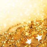 Luzes abstratas do feriado do ouro Fotos de Stock Royalty Free
