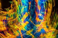 Luzes abstratas no movimento com cores múltiplas Imagens de Stock