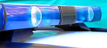 luzes azuis das sirenes do carro de polícia Imagens de Stock