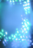 Luzes brancas geométricas do bokeh no fundo azul Fotografia de Stock Royalty Free