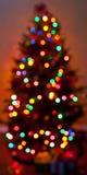 Luzes coloridas Defocused da árvore de Natal ilustração stock